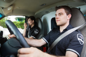 Men driving while team member talks with dispatcher