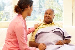 caregiver talking to an elderly senior